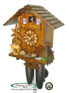 Up for auction genuine hand made Black Forest cuckoo clock. New